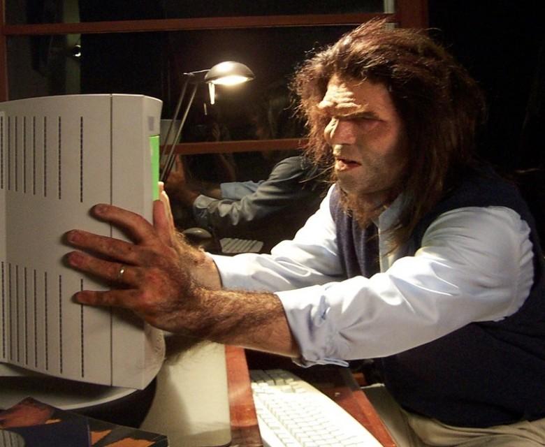 Caveman fixing computer