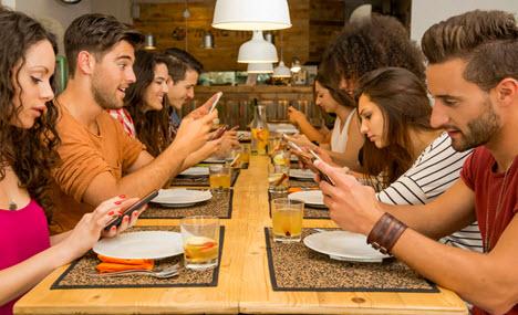 group watching smartphones